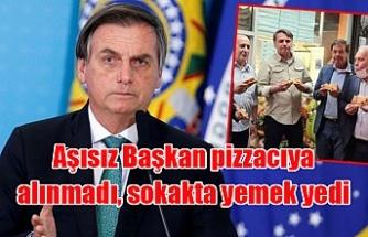 Aşısız Başkan pizzacıya alınmadı, sokakta yemek yedi